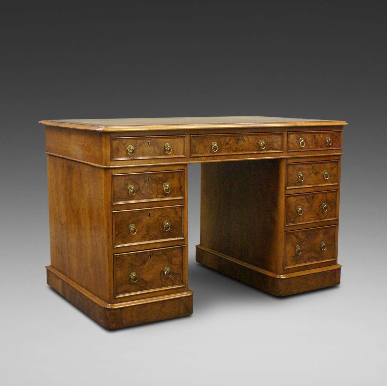 19th Century figured walnut nine drawer pedestal desk