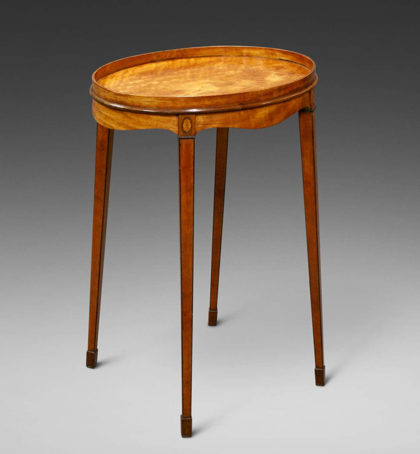 A George III oval satinwood inlaid urn stand