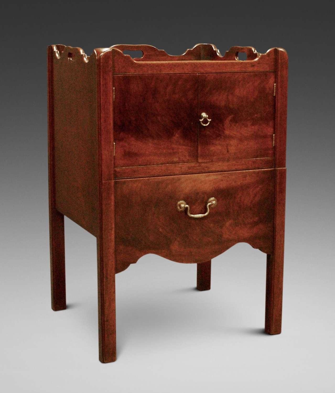 A George III period mahogany tray top bedside cupboard